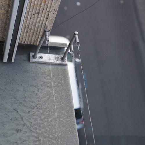 bird wire deterrent on a window sill